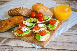 Small tasty bites for breakfast on wooden table